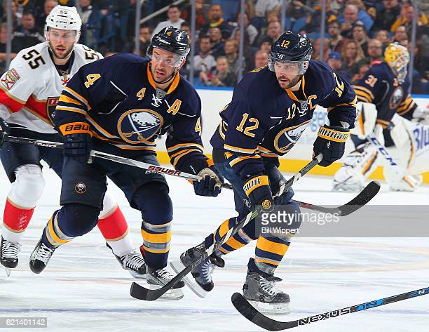 Josh Gorges and Brian Gionta of the Buffalo Sabres skate against the Florida Panthers during an NHL game at the KeyBank Center on October 29 2016 in...