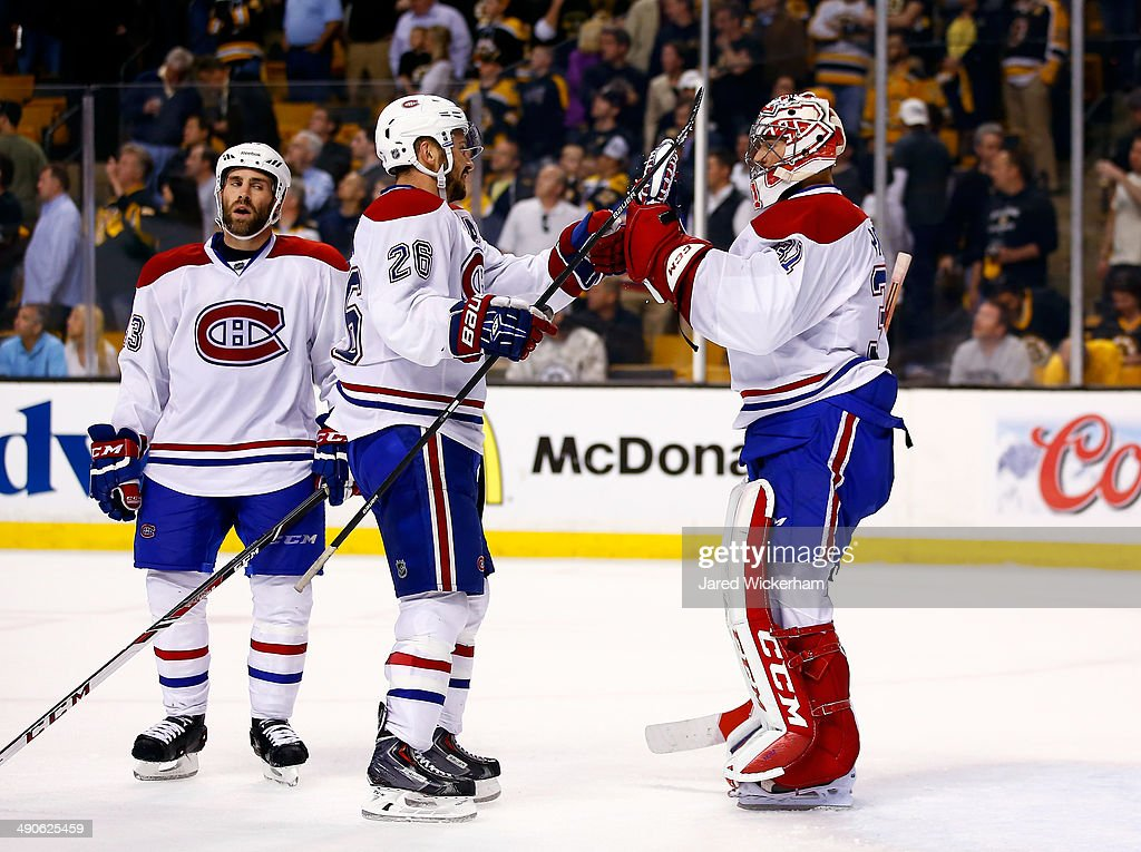 Josh Gorges #26 congratulates Carey Price #31 of the Montreal Canadiens after defeating the Boston Bruins 3-1 in Game Seven of the Second Round of the 2014 NHL Stanley Cup Playoffs at the TD Garden on May 14, 2014 in Boston, Massachusetts.