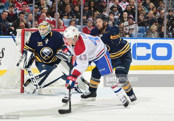 Josh Gorges of the Buffalo Sabres battles for position with Daniel Carr of the Montreal Canadiens in front of Linus Ullmark during an NHL game on...