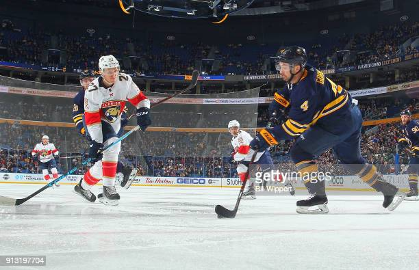 Josh Gorges of the Buffalo Sabres controls the puck against Nick Bjugstad of the Florida Panthers during the second period of an NHL game on February...