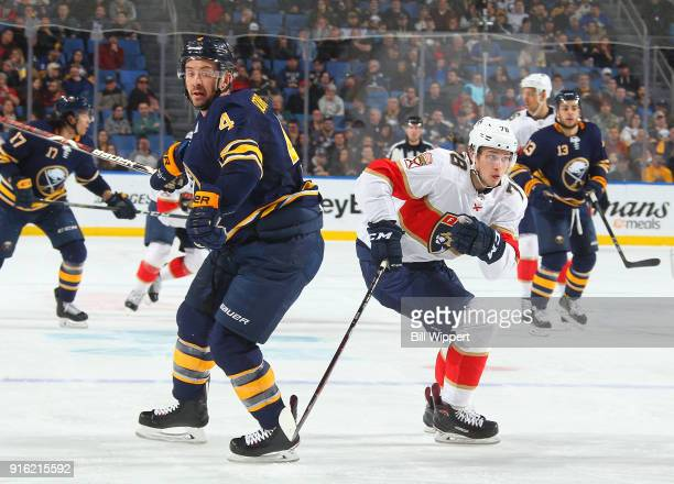 Josh Gorges of the Buffalo Sabres defends against Maxim Mamin of the Florida Panthers during an NHL game on February 1 2018 at KeyBank Center in...