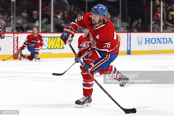 Josh Gorges of the Montreal Canadiens fires a shot during warmup prior to Game Six of the Second Round of the 2014 NHL Stanley Cup Playoffs against...