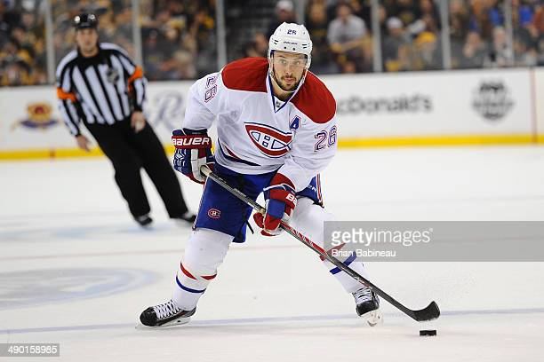 Josh Gorges of the Montreal Canadiens holds the puck against the Boston Bruins in Game Five of the Second Round of the 2014 Stanley Cup Playoffs at...