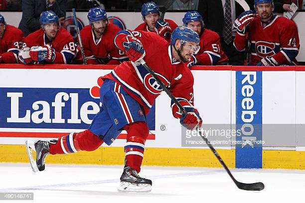 Josh Gorges of the Montreal Canadiens shoots the puck against the Boston Bruins in Game Four of the Second Round of the 2014 NHL Stanley Cup Playoffs...