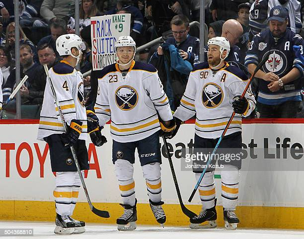 Josh Gorges Sam Reinhart and Ryan O'Reilly of the Buffalo Sabres celebrate Reinhart's hat trick goal against the Winnipeg Jets at the MTS Centre on...