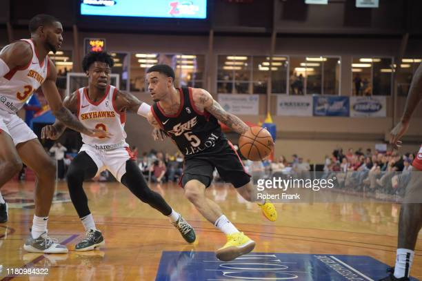 Josh Gray of the Erie BayHawks drives against College Park SkyHawks defenders during a G League game between the Erie BayHawks and the College Park...