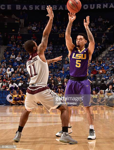 Josh Gray of the LSU Tigers plays against Anthony Collins of the Texas AM Aggies in an SEC Basketball Tournament Semifinals game at Bridgestone Arena...