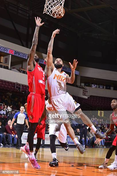 Josh Gray of the Northern Arizona Suns shoots against Chris Walker of the Rio Grande Valley Vipers on December 9 at Prescott Valley Event Center in...