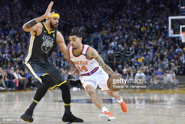Josh Gray of the Phoenix Suns drives to the basket on JaVale McGee of the Golden State Warriors during an NBA basketball game at ORACLE Arena on...
