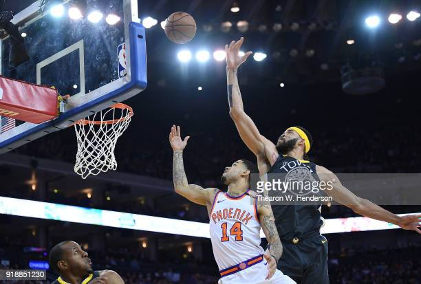Josh Gray of the Phoenix Suns gets his shot off in front of JaVale McGee of the Golden State Warriors during an NBA basketball game at ORACLE Arena...