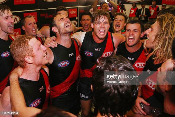 Josh Green Jobe WatsonMichael Hurley Brent Stanton and Dyson Heppell of the Bombers sing the club song after winning during the round one AFL match...