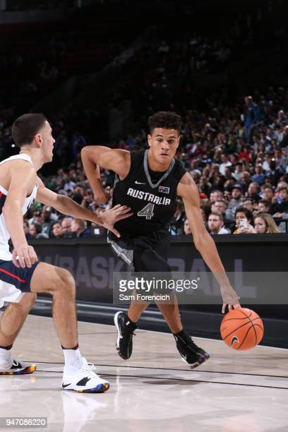 Josh Green of Team World dribbles the ball against Team USA during the Nike Hoop Summit on April 13 2018 at the MODA Center Arena in Portland Oregon...