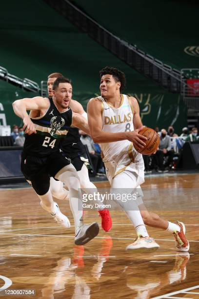 Josh Green of the Dallas Mavericks drives to the basket during the game against the Milwaukee Bucks on January 15, 2021 at the Fiserv Forum Center in...