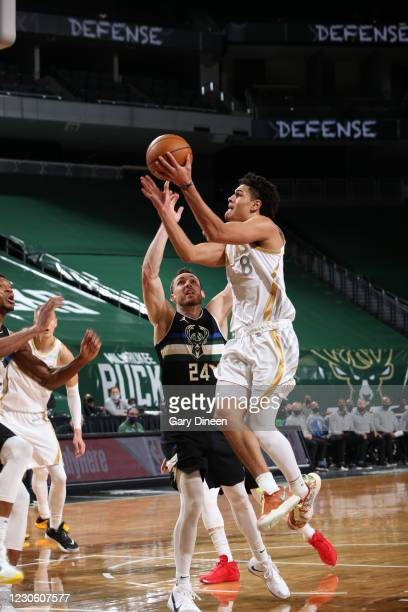 Josh Green of the Dallas Mavericks shoots the ball during the game against the Milwaukee Bucks on January 15, 2021 at the Fiserv Forum Center in...