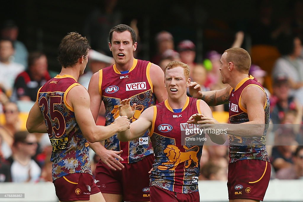 Josh Green of the Lions celebrates a goal with team mates during the round nine AFL match between the Brisbane Lions and the St Kilda Saints at The Gabba on May 31, 2015 in Brisbane, Australia.