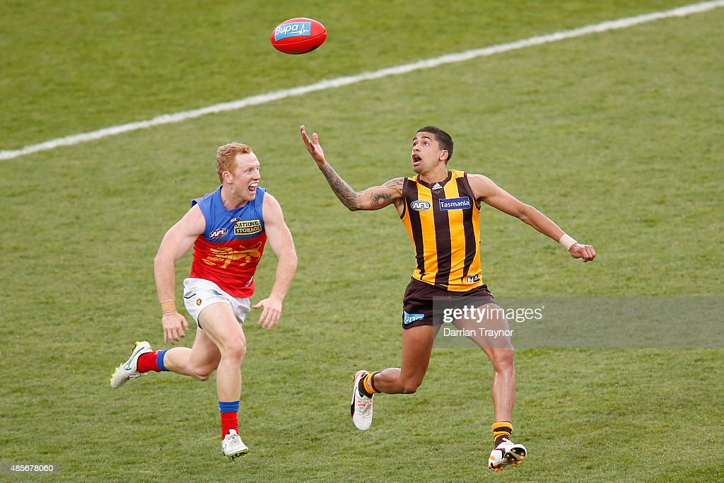 Josh Green of the Lions chases Bradley Hill of the Hawks during the round 22 AFL match between the Hawthorn Hawks and the Brisbane Lions at Aurora Stadium on August 29, 2015 in Launceston, Australia.
