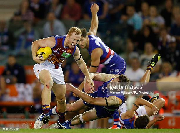 Josh Green of the Lions eludes Jordan Roughead of the Bulldogs during the 2016 AFL Round 05 match between the Western Bulldogs and the Brisbane Lions...