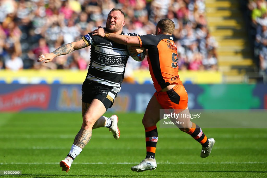 Josh Griffin of Hull FC is challenged by Paul McShane of Castleford Tigers during the Betfred Super League match between Hull FC and Castleford Tigers at KCOM Stadium on May 5, 2018 in Hull, England.