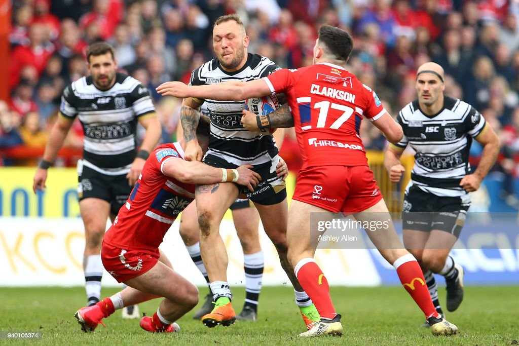 Josh Griffin of Hull FC is slowed down by James Donaldson and Chris Clarkson of Hull KR during the BetFred Super League match between Hull KR and Hull FC at KCOM Craven Park on March 30, 2018 in Hull, England.