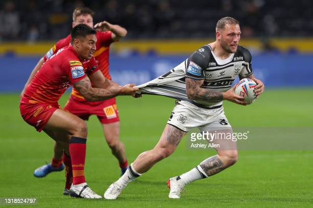 Josh Griffin of Hull FC is tackled by Dean Whare of Catalans Dragons during the Betfred Super League round 6 match between Hull FC and Catalans...