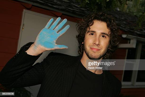 Josh Groban takes a break to make his handprint in the official book during the recording of his contribution to the new disaster relief charity...