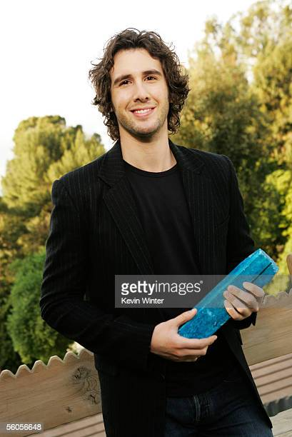 Josh Groban takes a break to sign the symbolic blue brick during the recording of his contribution to the new disaster relief charity single a cover...
