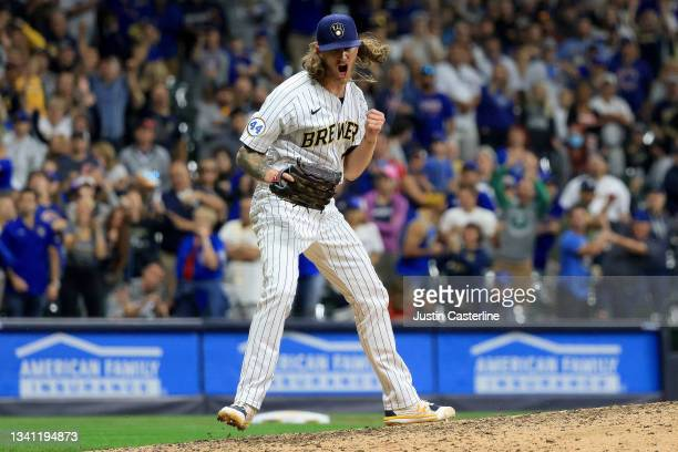 Josh Hader of the Milwaukee Brewers celebrates after a strike out during the ninth inning in the game against the Chicago Cubs at American Family...