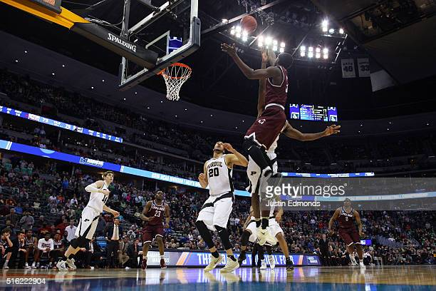 Josh Hagins of the Arkansas Little Rock Trojans makes a shot against the Purdue Boilermakers in double overtime during the first round of the 2016...
