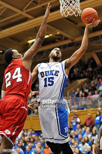 Josh Hairston of the Duke Blue Devils goes to the hoop against Kimani Hunt of the WinstonSalem State Rams at Cameron Indoor Stadium on November 1...
