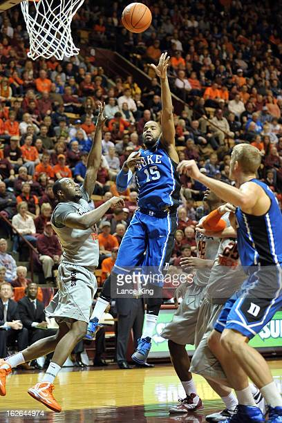 Josh Hairston of the Duke Blue Devils puts up a shot against Cadarian Raines of the Virginia Tech Hokies at Cassell Coliseum on February 21 2013 in...