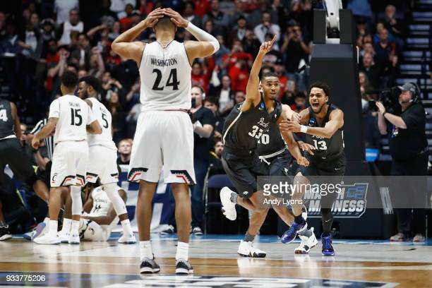 Josh Hall of the Nevada Wolf Pack celebrates with Hallice Cooke after defeating the Cincinnati Bearcats during the second half in the second round of...