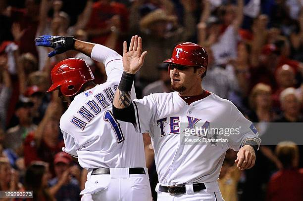 Josh Hamilton and Elvis Andrus of the Texas Rangers celebrate after scoring in the third inning to tie Game Six of the American League Championship...