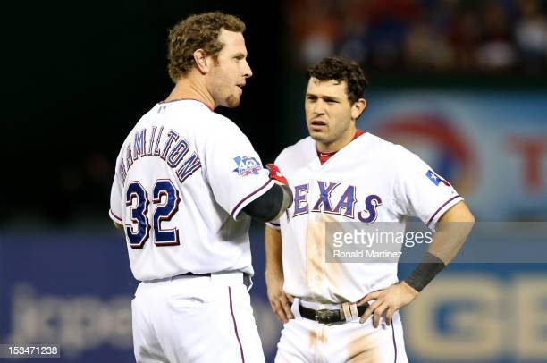 Josh Hamilton and Ian Kinsler of the Texas Rangers look on after Hamilton struck out to end the bottom of the eighth inning against the Baltimore...