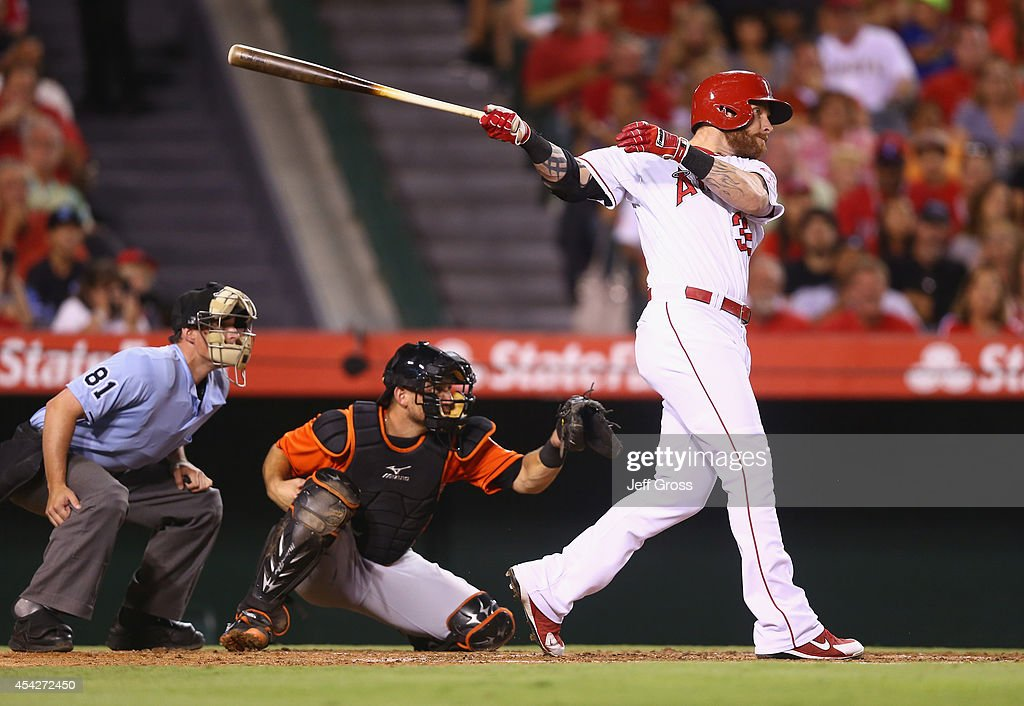 Josh Hamilton #32 of the Los Angeles Angels of Anaheim hits an RBI double against the Miami Marlins in the third inning at Angel Stadium of Anaheim on August 27, 2014 in Anaheim, California.