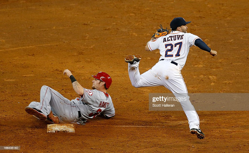Josh Hamilton #32 of the Los Angeles Angels of Anaheim is forced out at second base by Jose Altuve #27 of the Houston Astros in the ninth inning at Minute Maid Park on May 8, 2013 in Houston, Texas.