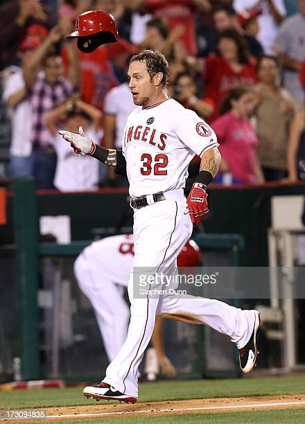 Josh Hamilton of the Los Angeles Angels of Anaheim throws his helmet as he runs home after hitting a two run walk off home run in the 11th inning...