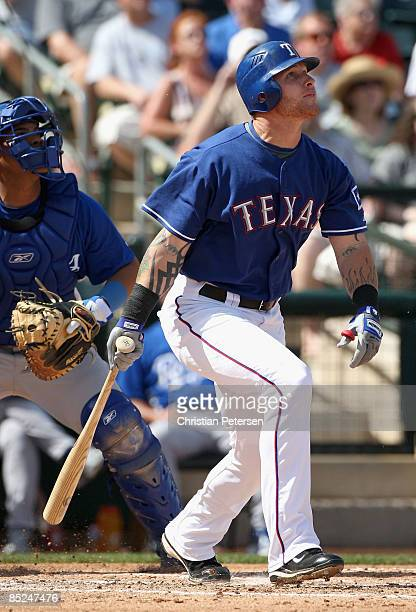 Josh Hamilton of the Texas Rangers bats against the Kansas City Royals during the spring training game at Surprise Stadium on March 4 2009 in...