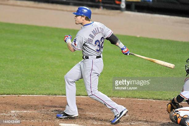 Josh Hamilton of the Texas Rangers hits a home run in the ninth inning during a baseball game against the Baltimore Orioles at Oriole Park at Camden...