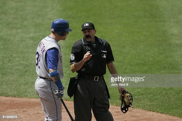 Josh Hamilton of the Texas Rangers is ejected from the game by home plate umpire Bill Hohn during the game against the Cleveland Indians at...