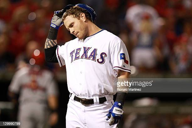 Josh Hamilton of the Texas Rangers reacts after making the last out of the third inning during Game Three of the MLB World Series against the St...