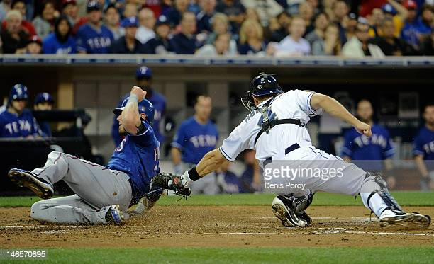 Josh Hamilton of the Texas Rangers scores ahead of the tag of Nick Hundley of the San Diego Padres during the third inning of an interleague baseball...