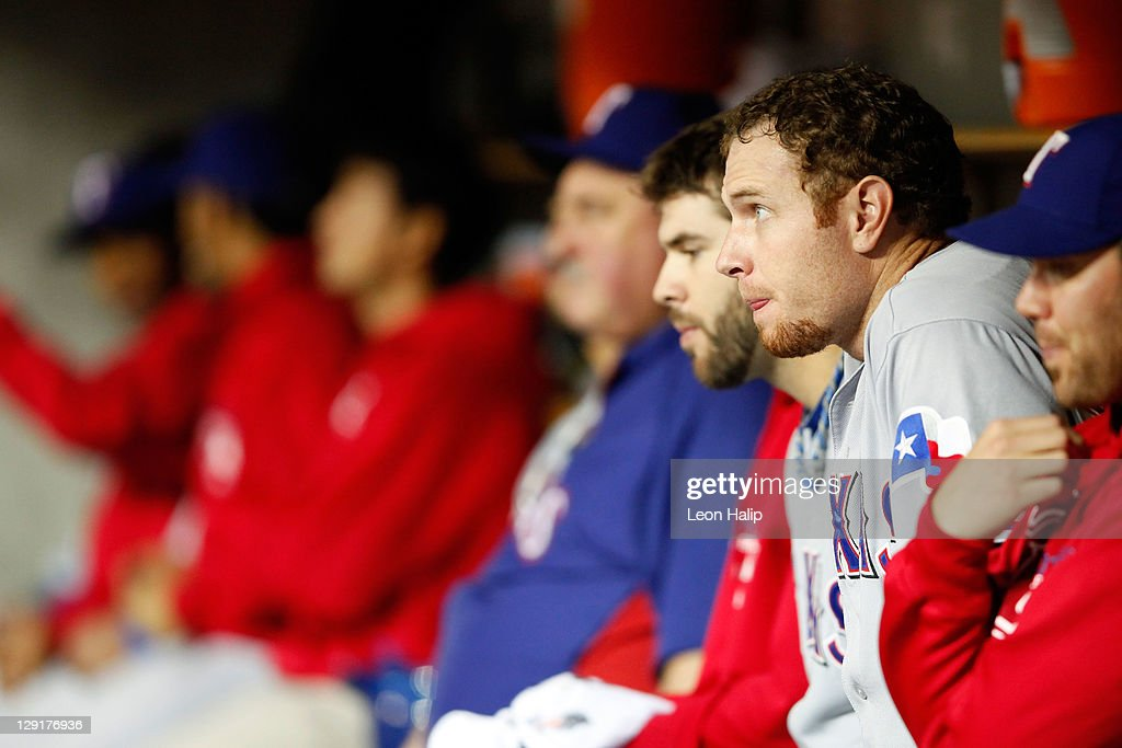 Josh Hamilton #32 of the Texas Rangers sits in the dugout during Game Five of the American League Championship Series against the Detroit Tigers at Comerica Park on October 13, 2011 in Detroit, Michigan.