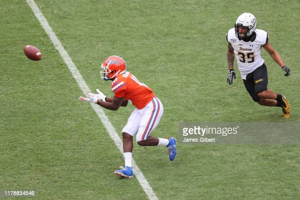 Josh Hammond of the Florida Gators catches a pass against Coby Tippett of the Towson Tigers during the third quarter of a game at Ben Hill Griffin...