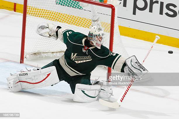 Josh Harding of the Minnesota Wild makes a save against the Chicago Blackhawks in Game Three of the Western Conference Quarterfinals during the 2013...