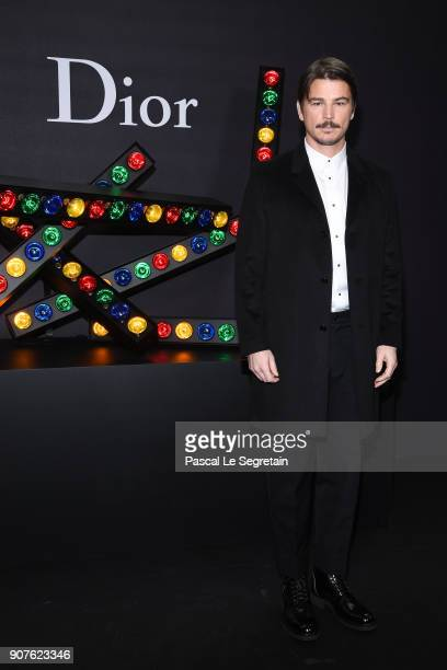 Josh Harnett poses at Dior Homme Menswear Fall/Winter 20182019 show as part of Paris Fashion Week at Grand Palais on January 20 2018 in Paris France