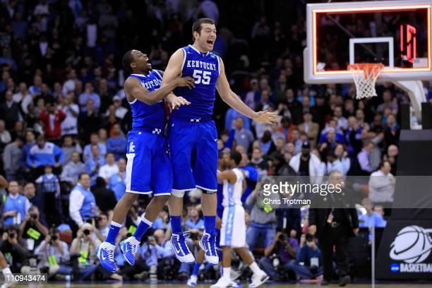 Josh Harrellson and Stacey Poole Jr #2 of the Kentucky Wildcats jump up in the air to celebrate their win against the North Carolina Tar Heels in the...