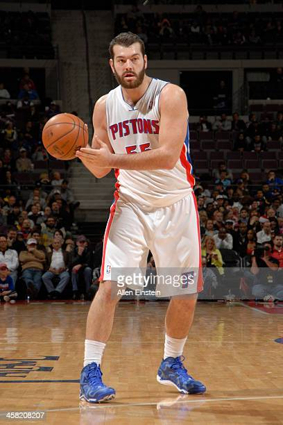 Josh Harrellson of the Detroit Pistons looks to pass the ball against the Charlotte Bobcats on December 20 2013 at The Palace of Auburn Hills in...