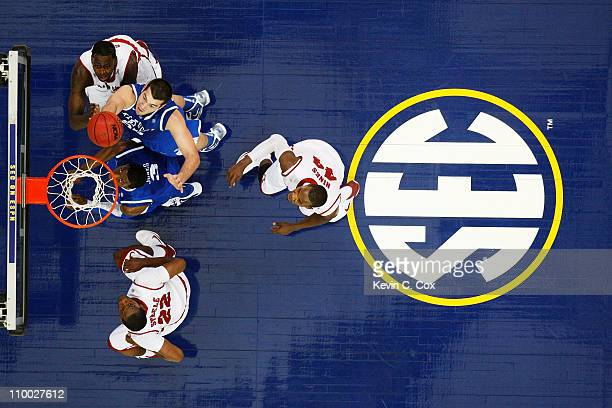 Josh Harrellson of the Kentucky Wildcats shoots against the Alabama Crimson Tide during the semifinals of the SEC Men's Basketball Tournament at...
