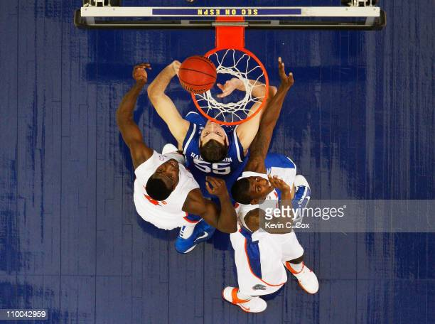 Josh Harrellson of the Kentucky Wildcats shoots against the Florida Gators in the championship game of the SEC Men's Basketball Tournament at Georgia...