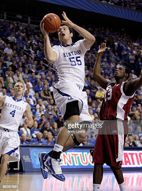 Josh Harrellson of the Kentucky Wildcats shoots the ball during the game against the Rider Broncs on November 21, 2009 at Rupp Arena in Lexington,...